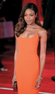 British actress Naomie Harris poses on arrival for the world premiere of the new James Bond film 'Spectre' at the Royal Albert Hall in London on October 26, 2015. The film is directed by Sam Mendes and sees Daniel Craig play suave MI6 spy 007 for a fourth time. AFP PHOTO / LEON NEAL (Photo credit should read LEON NEAL/AFP/Getty Images)