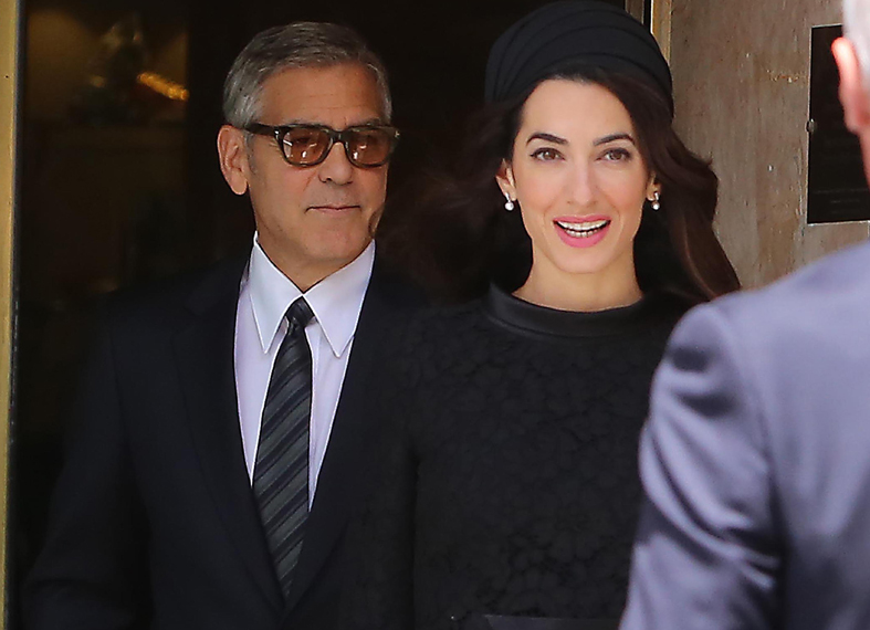 George Clooney and his wife Amal Alamuddin come out from their hotel in Rome, Italy.